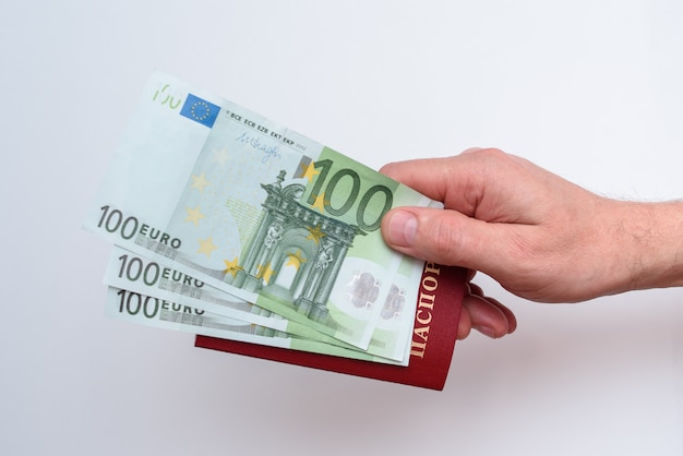 Russian international passport with euro in the man's hand Premium Photo