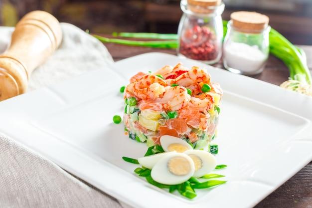 Russian salad with shrimps Premium Photo