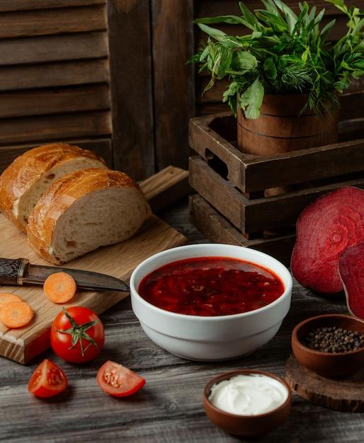 Russian soup borshch in white bowl Free Photo