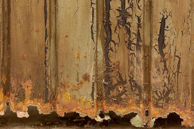 Superficie di metallo arrugginita con scheggiatura della vernice Foto Gratuite