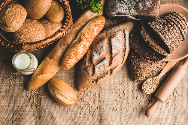 Rustic arrangement of healthy bread loaves Free Photo