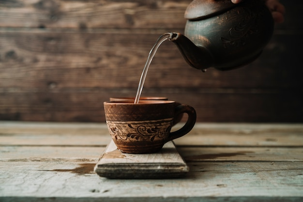 Rustic arrangement of teapot and cup Free Photo
