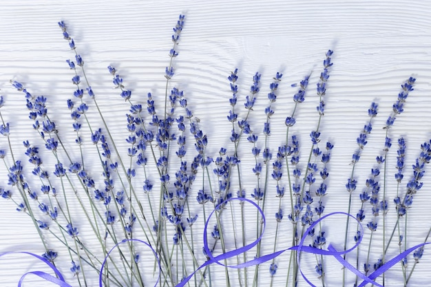 Rustic background with lavender flowers on white wooden surface. selective focus. Premium Photo