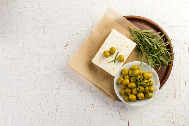 Rustic background with olives and aromatic herb Premium Photo