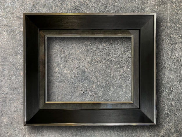 Rustic picture frame on cement wall Premium Photo
