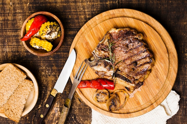 Rustic serving of dinner with beefsteak Free Photo