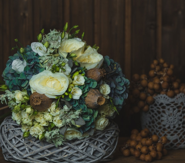 Rustic style flower bouquet and blossoma in baskets Free Photo