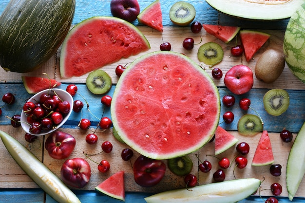 Rustic table full of pieces of watermelon, melon Premium Photo