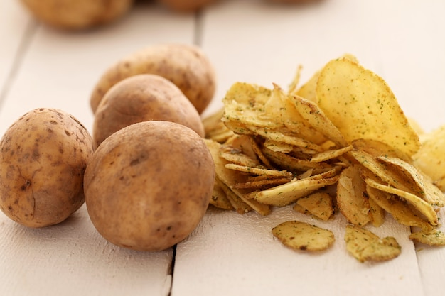 Rustic unpeeled potatoes and chips Free Photo
