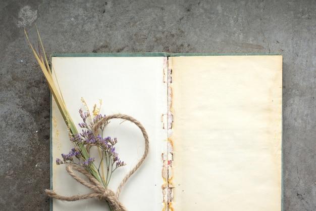 Rustic vintage note book on rough concrete Premium Photo