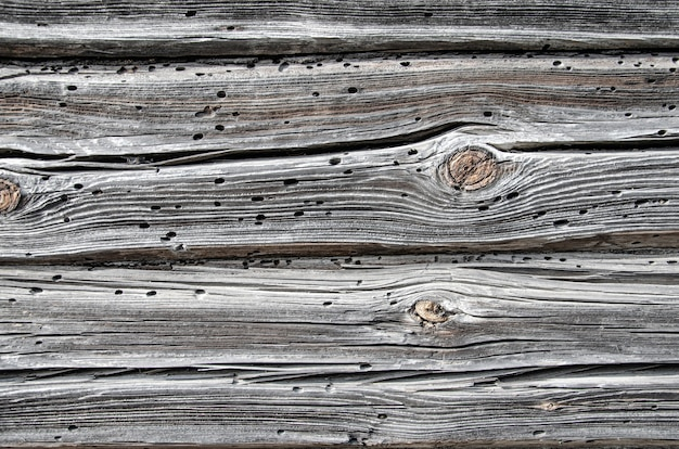 Rustic weathered barn wood background with knots and nail holes Premium Photo