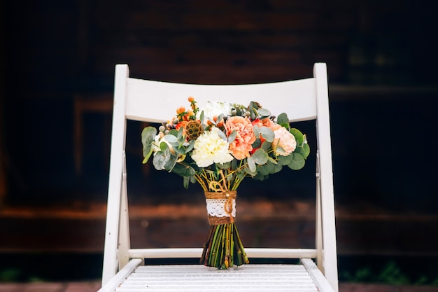 rustic wedding centerpiece ideas rustic wedding chic.htm rustic wedding bouquet and delicate bridal shoes on a white chair  delicate bridal shoes on a white chair