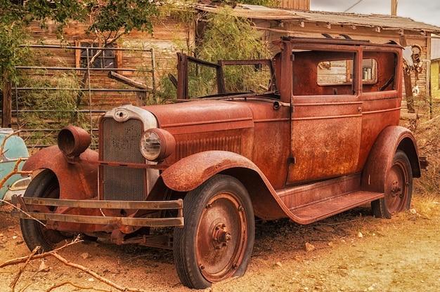 Rusty abandoned brown car in hackberry, arizona, usa Premium Photo