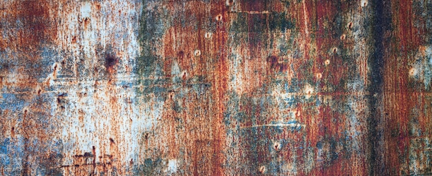 Rusty metal wall, old sheet of iron covered with rust with multi Premium Photo