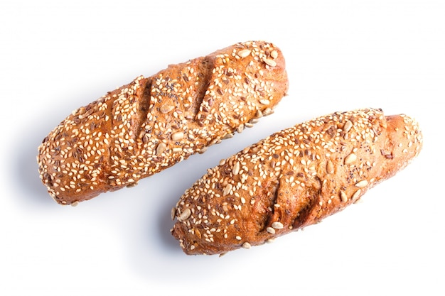 Rye bread with sunflower seeds, sesame and flax isolated on white. Premium Photo
