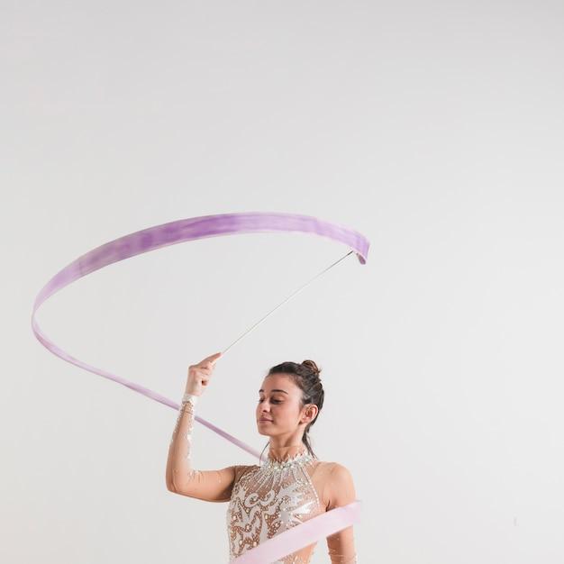 Rythmic gymnast posing with the ribbon Free Photo