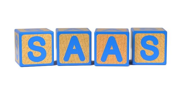 白で隔離される着色された木製の子供のアルファベットブロックのsaas。 Premium写真