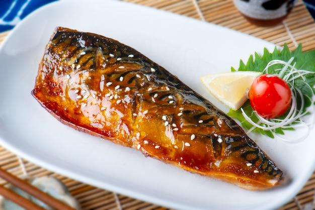 Saba fish grilled with sauce. Premium Photo