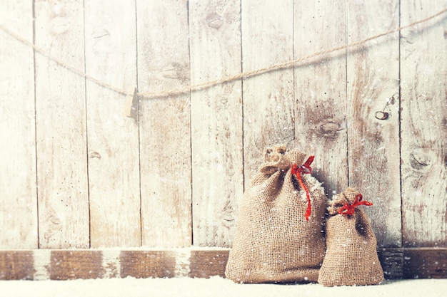 Sacks of fabric with a red bow Free Photo