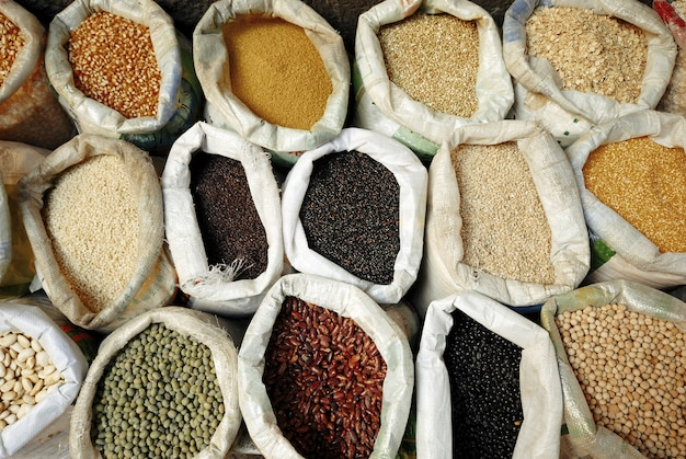 Sacks of healthy legumes and grains concept Premium Photo