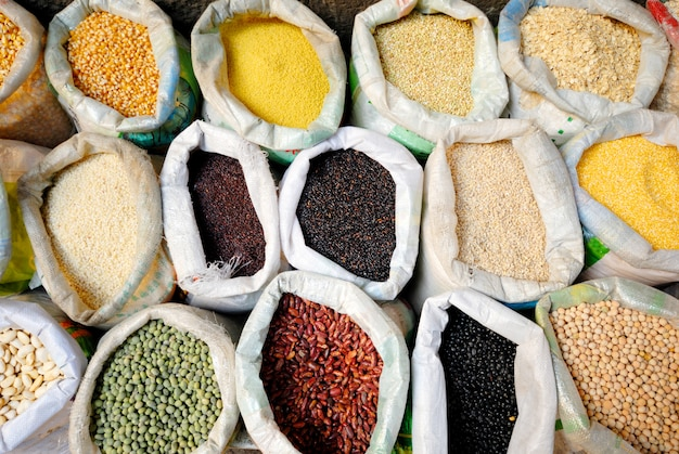 Sacks of healthy legumes and grains. Free Photo
