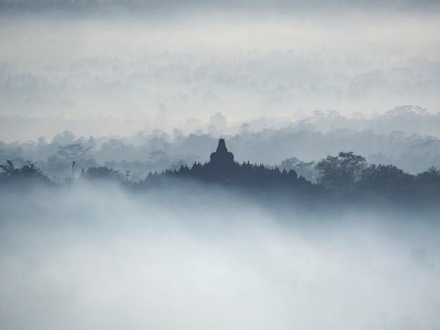 sacred-temple-borobudur-beautiful-foggy-sunrise-seen-from-setumbu-hill_57658-10.jpg