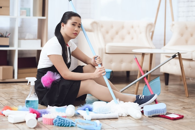 Sad asian housekeeper tired hard work concept Premium Photo