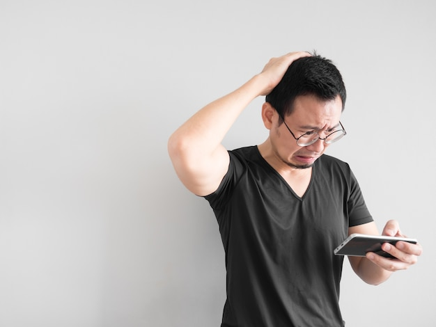 Sad Asian Man Lost The Game He Played In The Smartphone