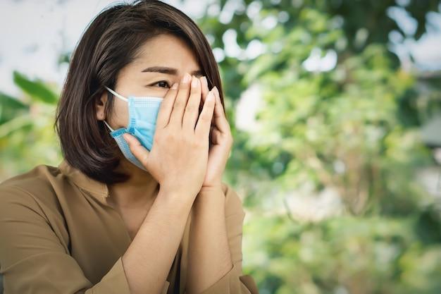 Sad asian woman wearing protective mask crying alone Premium Photo