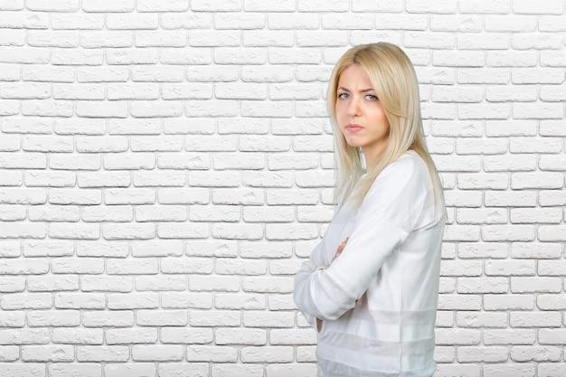 Sad beautiful young blond woman Premium Photo