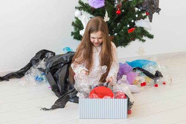 Sad child carrier box with plastic trash Premium Photo