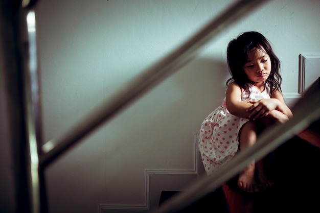 Sad child from this father and mother arguing, family negative concept.vintage color Premium Photo