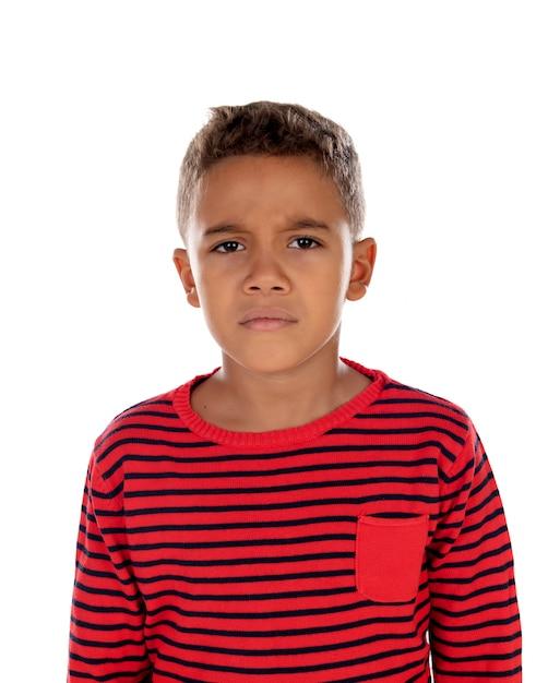 Sad child with red striped t-shirt Premium Photo