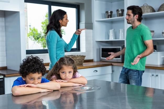 Sad children listening to parents argument Premium Photo
