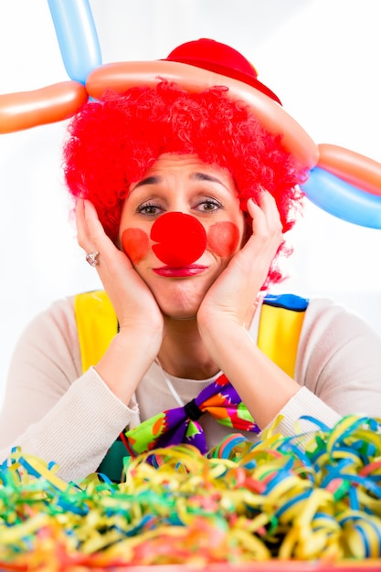 Sad clown being sick and tired of it all Premium Photo