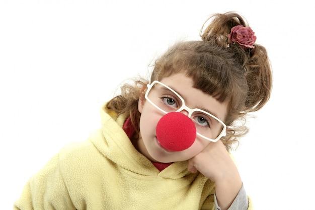 Sad clown nose little girl with big glasses Premium Photo