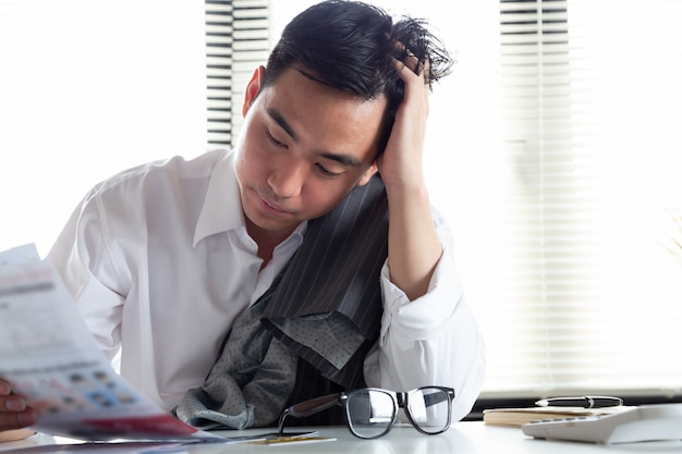Premium Photo   Sad confused and stressed of young asian man holding bills  letter of credit card debt, financial money problem and tax invoice  notification concept