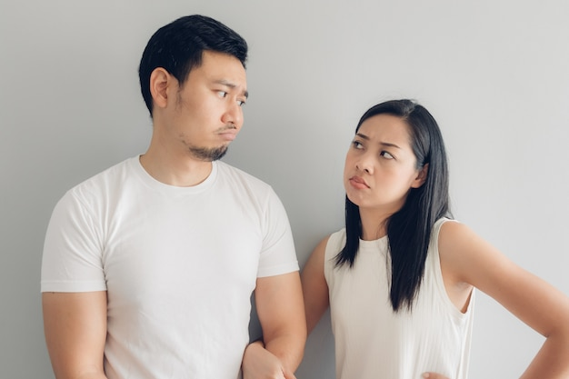 Sad couple lover in white t-shirt and grey background. Premium Photo