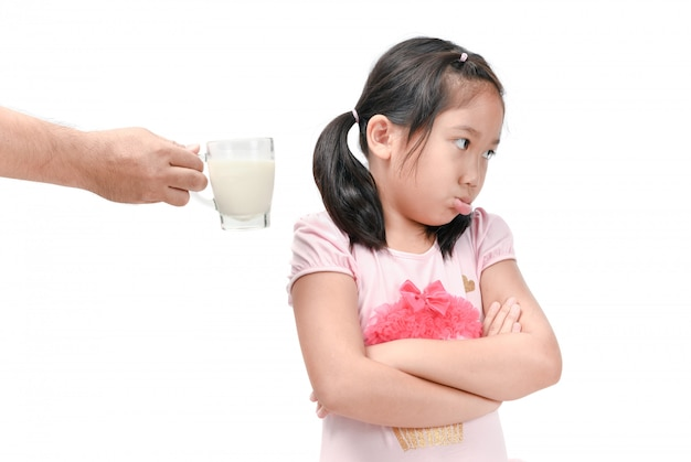 Sad girl refuses drink a fresh milk isolated Premium Photo