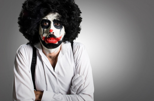 Sad killer clown on textured background Premium Photo