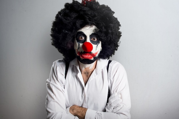 Sad killer clown on textured background Premium Photo