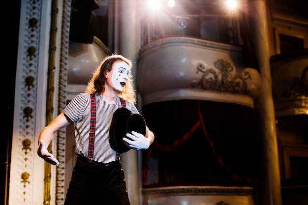 Sad male mime artist rehearsing in the auditorium Free Photo
