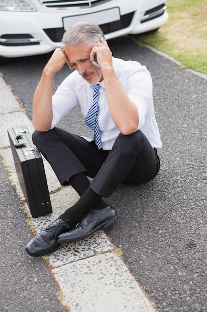 Sad man calling for assistance after breaking down  Premium Photo