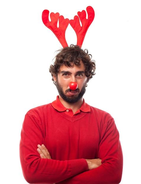 Sad man with reindeer antlers Free Photo