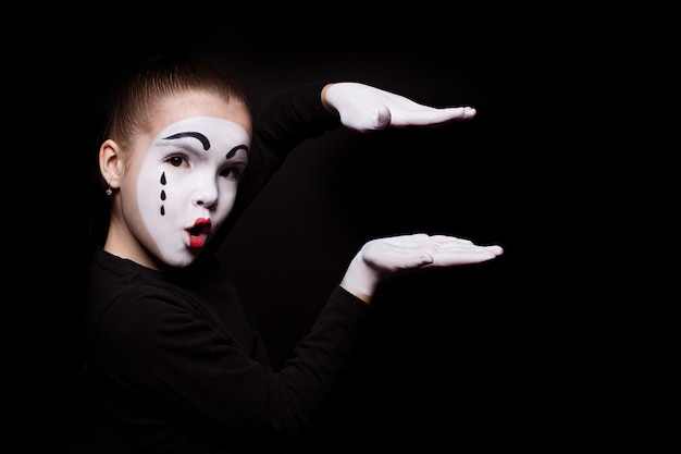 Sad mime holds his palms parallel in the air Premium Photo