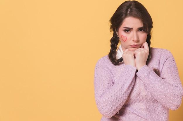 Sad woman posing while frowning Free Photo