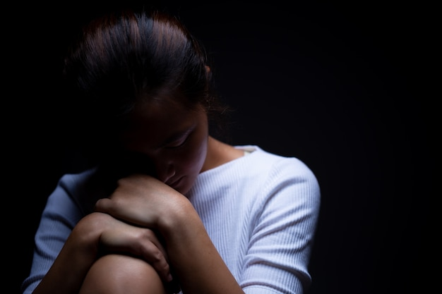 Sadness of a woman in the dark Premium Photo