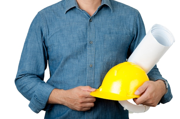 Safety concept. architecture wear blue shirt and hold yellow safety helmet and blue print Premium Photo