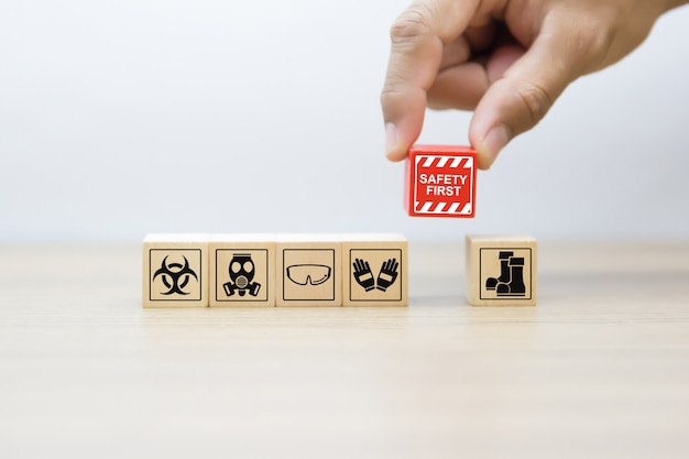 Safety and emergency graphics icons on wooden blocks. Premium Photo