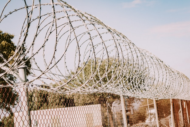 Safety fence of barbed wire Premium Photo